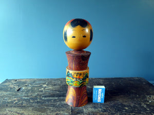 Kokeshi doll - red with painted bridge scene