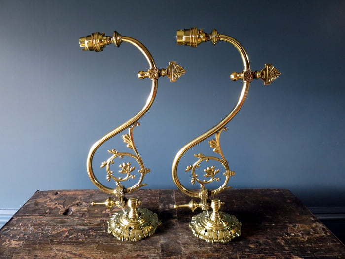 Pair of ornate Victorian brass converted gas swivel wall-lamps