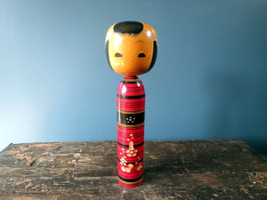 Japanese Kokeshi doll - Tsuchiyu style with bold coloured body and 3D petal design