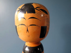 Vintage Japanese Kokeshi doll - Togatta style with black faded chrysanthemum pattern