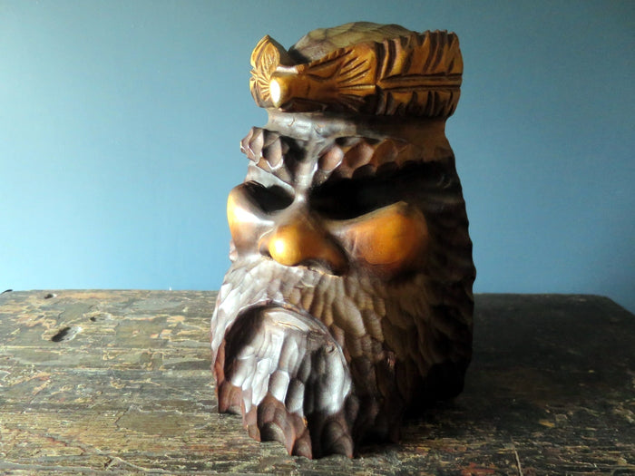 Rare Japanese hand-carved sculpture of Ainu man with eagle head-dress