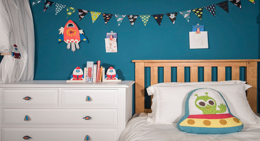 Space themed accessories in a children's bedroom interior