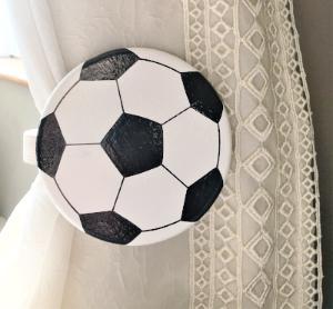 Childrens wooden football curtain tie backs