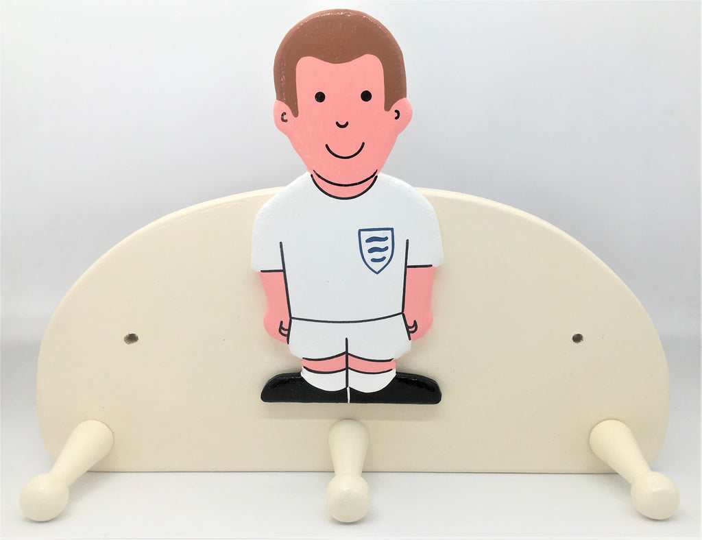 childrens footballer in white strip coat hook