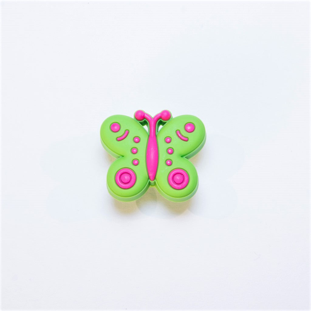 green and pink butterfly door knob