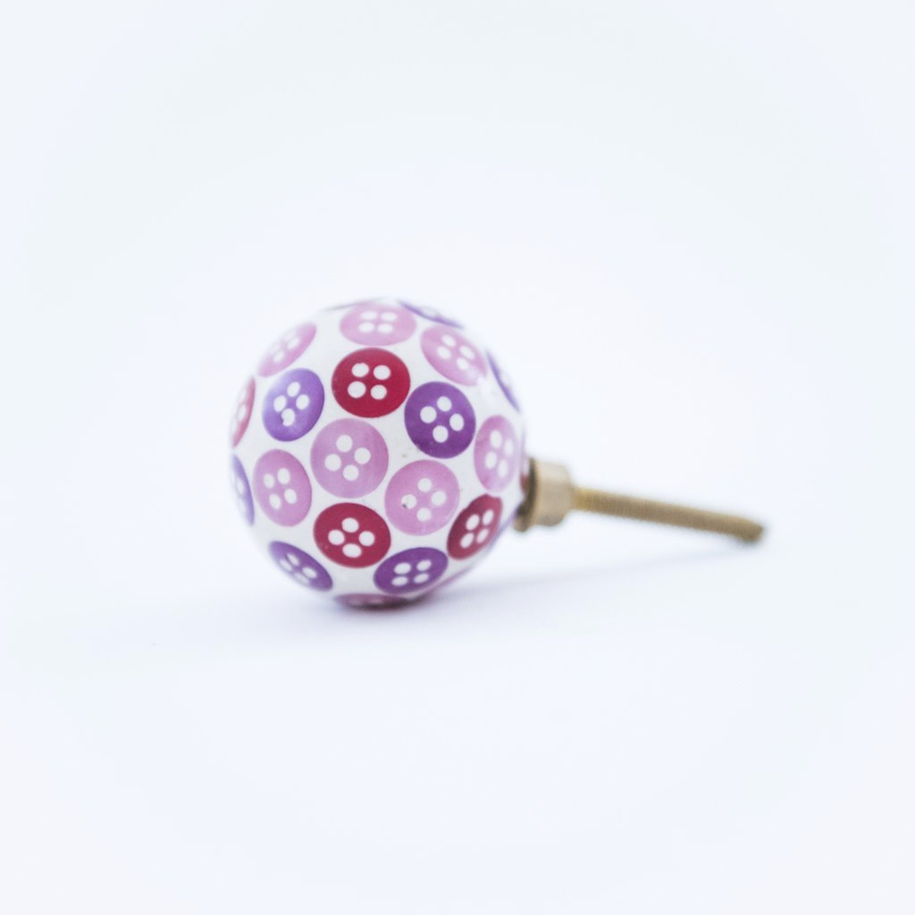 pink and purples button door knob