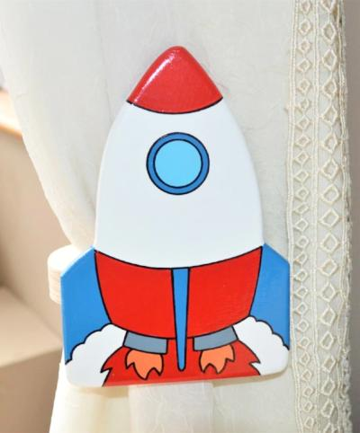 childrens wooden space rocket curtain tie backs