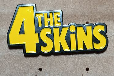 4 SKINS, THE ENAMEL BADGE