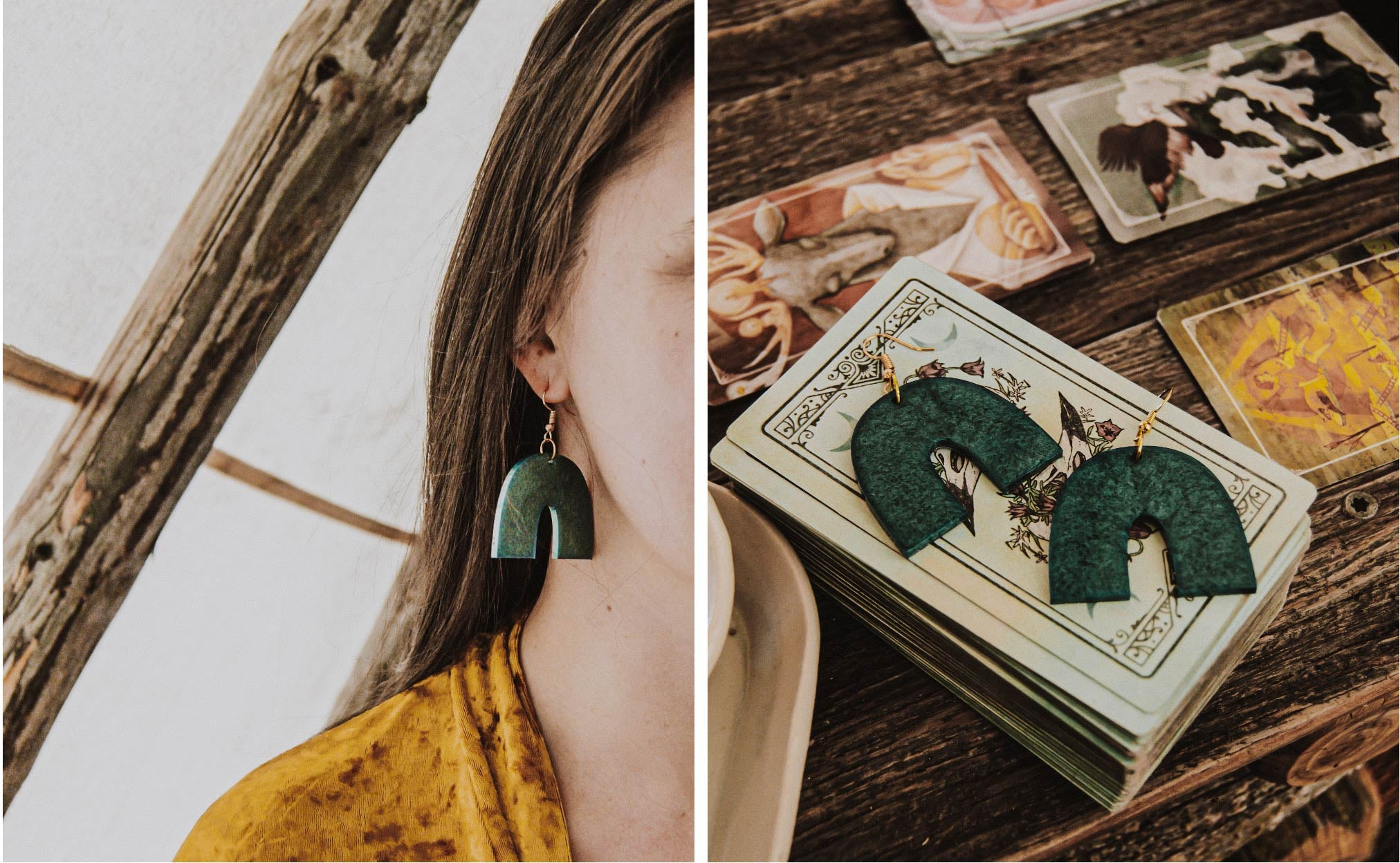woman wearing a handmade pair of dark teal resin earrings, earrings resting on a tarot deck