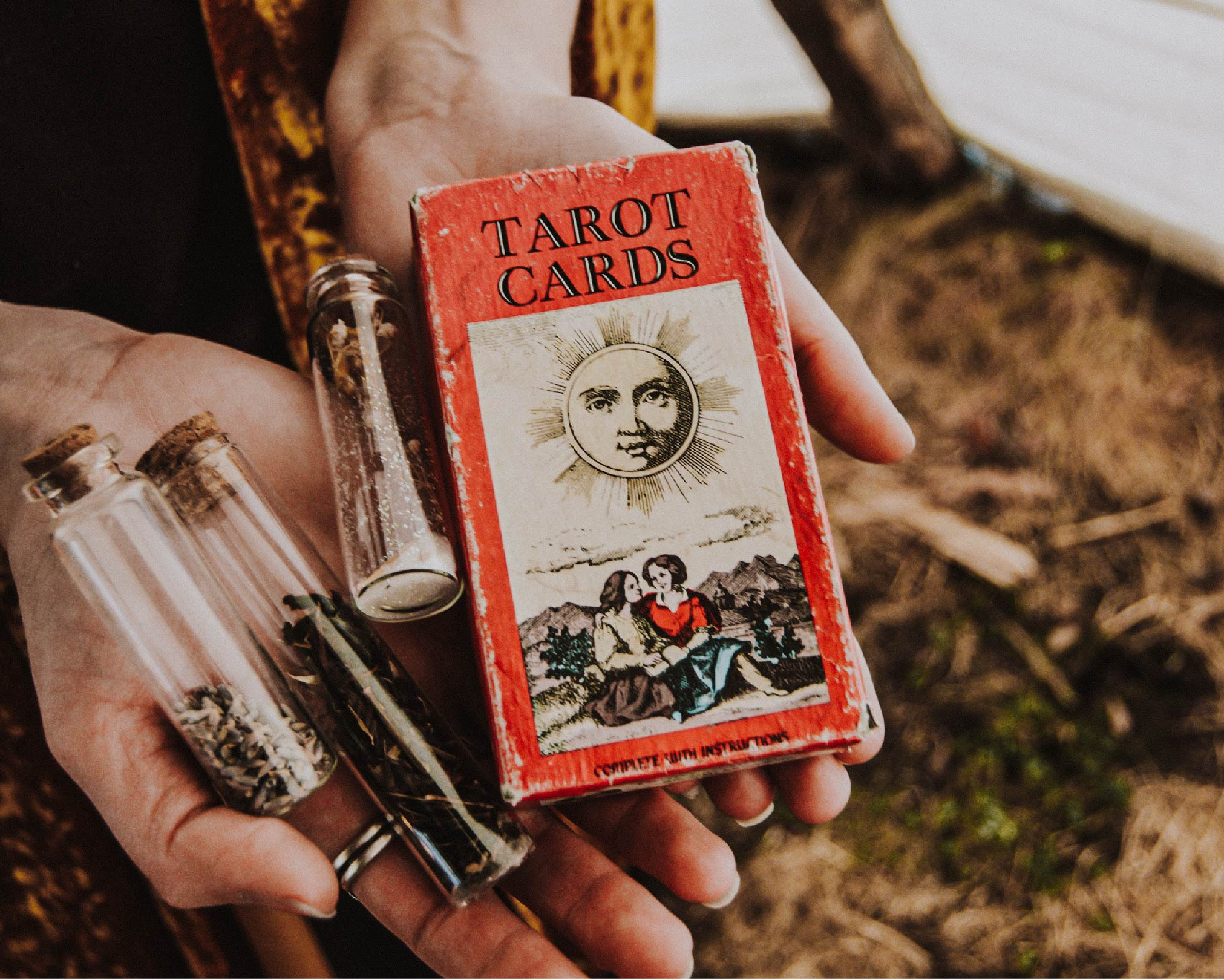 tarot card deck and magic herbs in a witches' vials