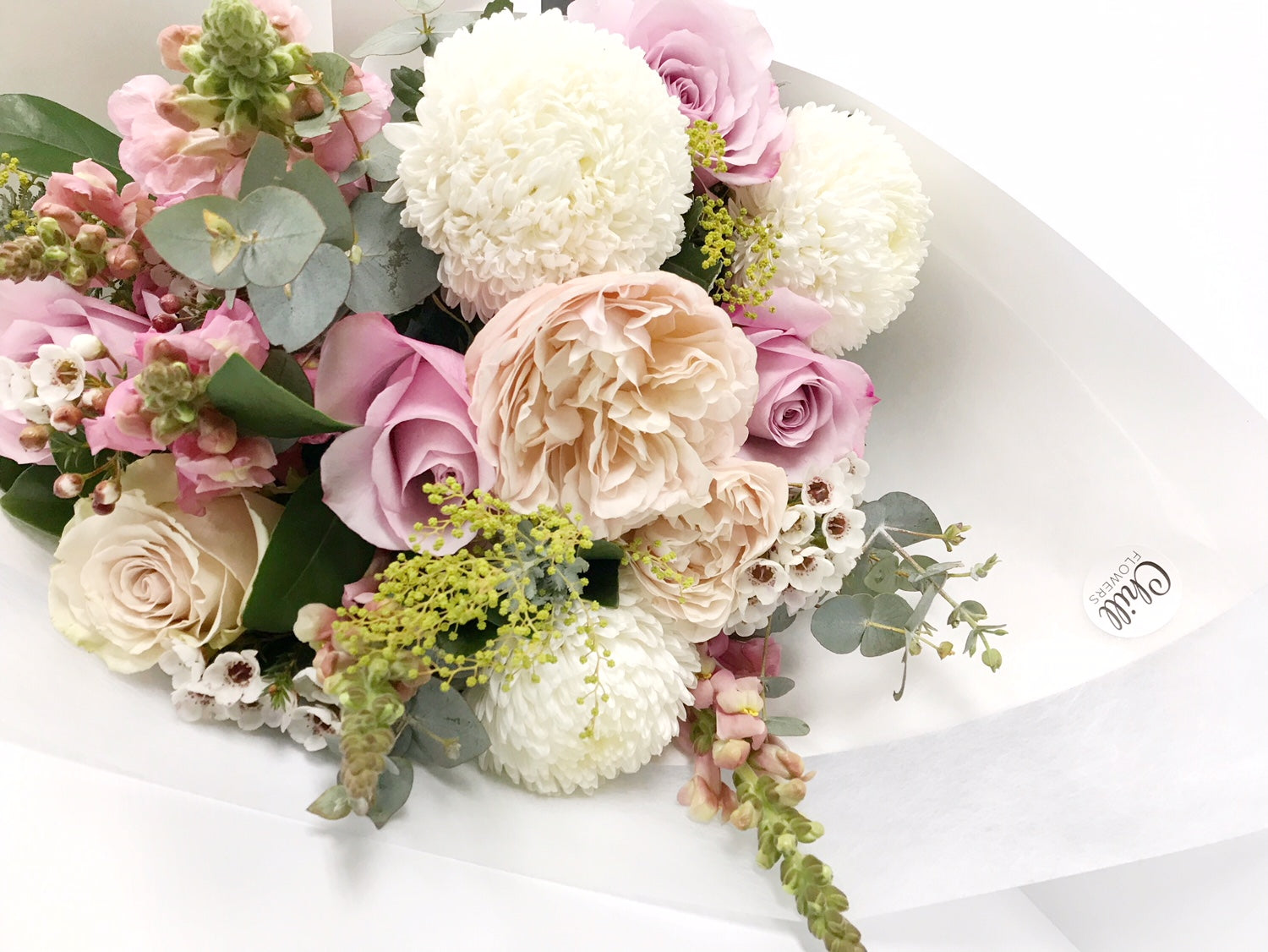 Beautiful Bouquet of David Austin Roses, Fluffy Chrysanthemums, Garden Roses, Blue Gum, Lisianthus, Snap Dragons, Wattle and Native Foliage.