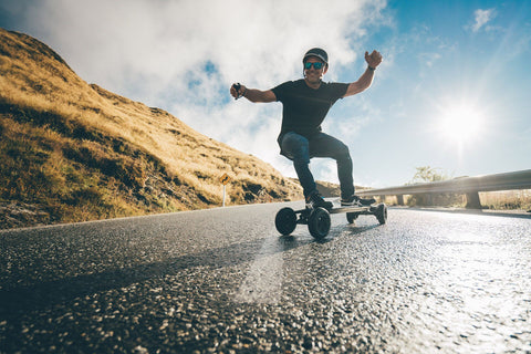 Carving up the road with an Evolve electric skateboard