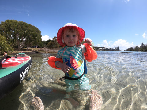 Child smiling after a paddle board adventure