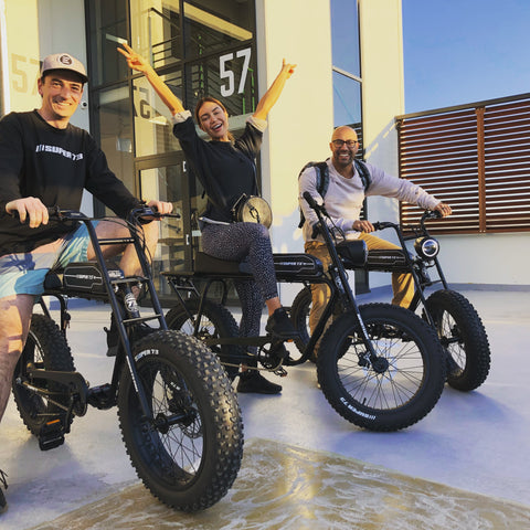 Outside Ben Buckler Boards HQ with Pia and Kane on Super73 bikes
