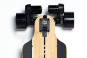 Close up of GTR Bamboo skateboard motor with 97mm street wheels