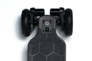 Close up of GTR Carbon skateboard motor with AT wheels by evolve