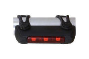 Rear light attached on bike frame by trident