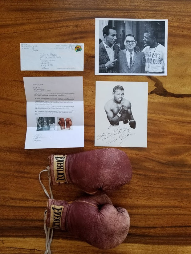 Sugar Ray Robinson training worn boxing gloves - Sold - - Formula 1 Memorabilia