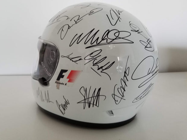 F1 helmet signed by all 28 drivers of the 2010 season - Sold - - Formula 1 Memorabilia