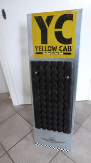 Original advertisement board of Yellow cab shoe co, New York - metal and rubber - Formula 1 Memorabilia