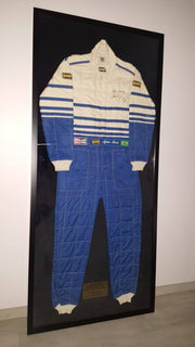 OMP race suit signed by Ayrton Senna