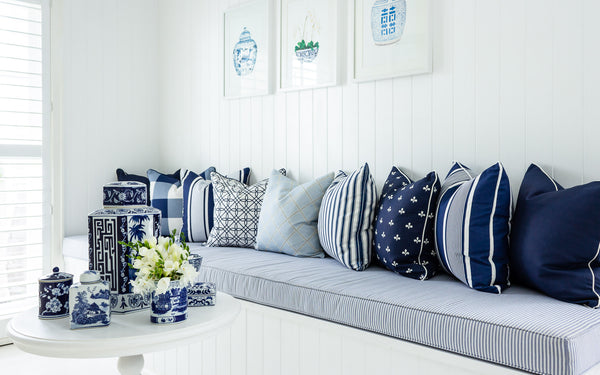 Blue and white cushions on bench seat