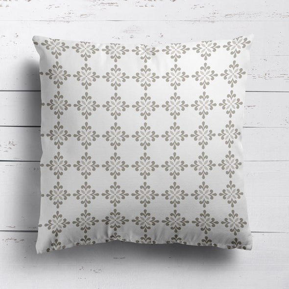Geometric flower motif cushion neutral