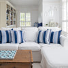 Coastal Blue stripe cushions on white sofa