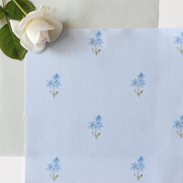 Forget Me Not cotton linen fabric on pale blue