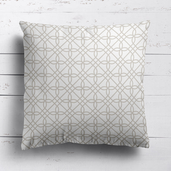 neutral trellis patterned fabric cushion
