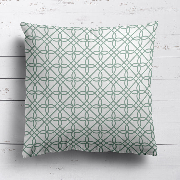 green trellis patterned fabric cushion
