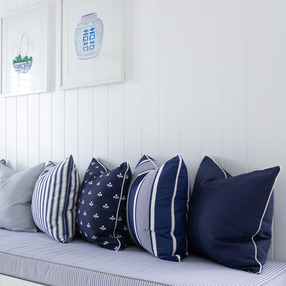 Navy blue cushion white piping