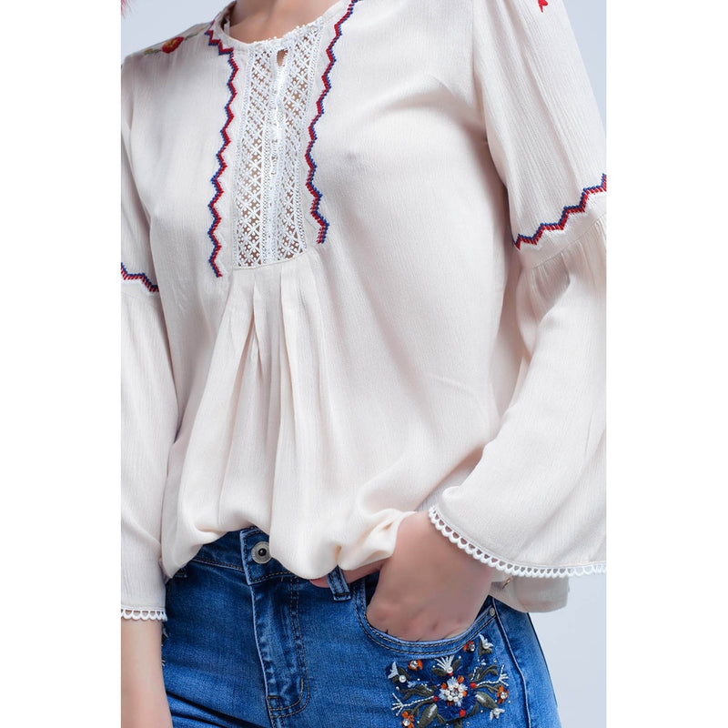 Beige Shirt with embroidered flowers