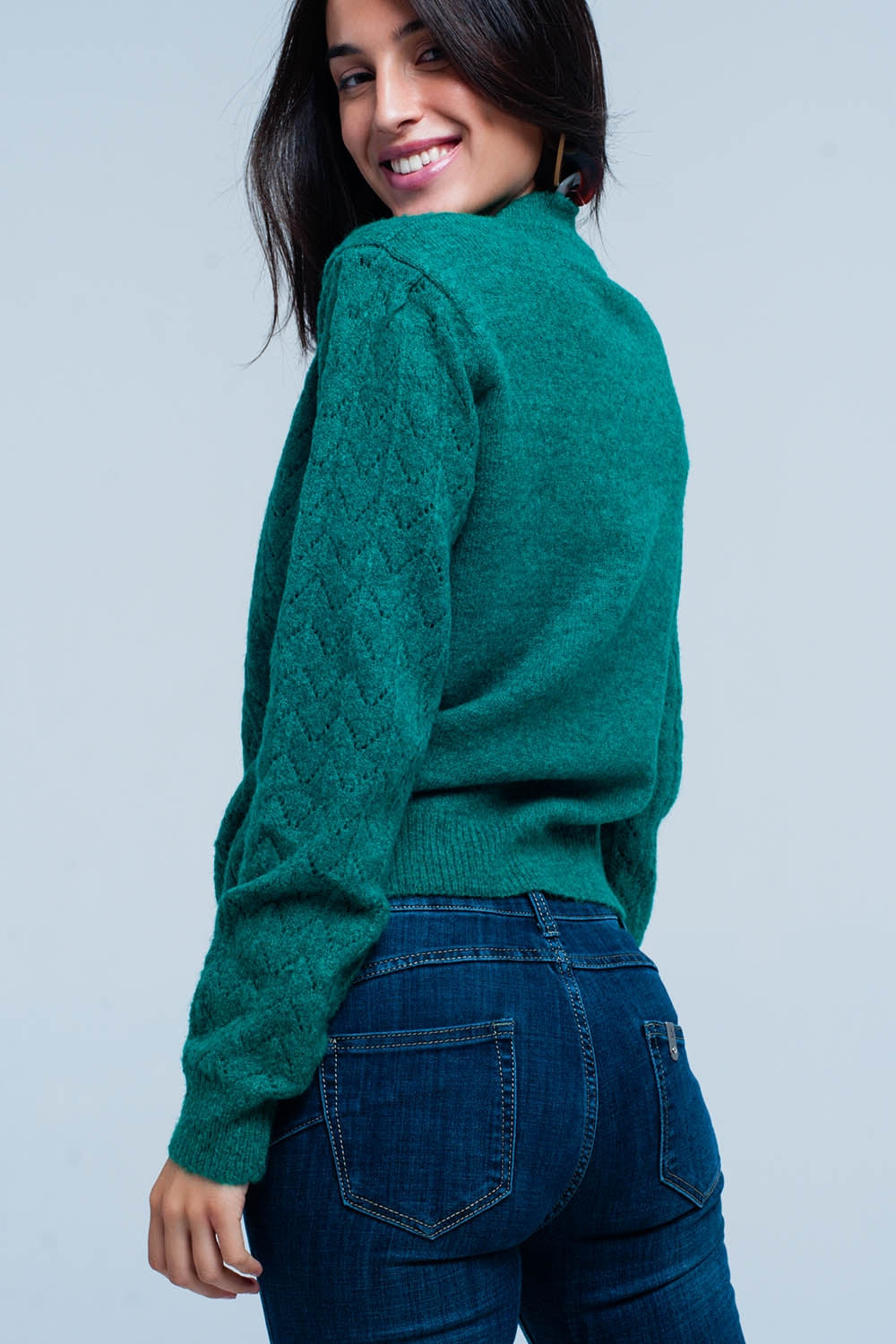 Green knitted sweater with crew neck