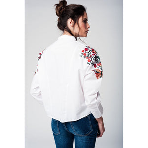 White blouse with flower