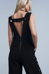 Black jumpsuit with side gold buttons