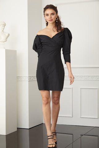 This is an image of the Farah Black mini dress which has a bardot neckline, volume in the sleeves and can be worn either on or off the shoulder