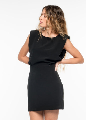 The Jodie Dress is Mini Length and has an Overlay detail that accentuates the waist and enhances that hourglass shape. It has an Invisible Zip Closure down the side.  This Little Black Dress can be worn for workwear or dressed up for a night on the town or Event. Its Simple Silhouette allows for Loads of Accessorising so throw on your most glamorous earrings and chunky necklace.  This dress is tight-fitting and structured so if you are between two sizes we recommend taking the larger size.