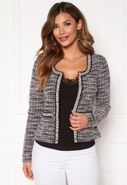 The Loren Jacket has a tweed like effect with red, Black and White threads throughout.  It has a stunning frayed finish along the inner edges and neckline and pocket details on the waist. This jacket is stunning styled over a simple Cami top with Jeans or Pants. We also sell the matching skirt for a full suit look. Sourced in Milan