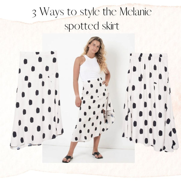 This is an Image of our Melanie Cream Midi Skirt with Black Spots.