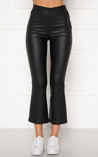 Alicia Coated Kick Flare Trousers Black €49.95  These Black, Coated Trousers are Cropped and are made of a Light, Stretchy fabric.  They have a Wet Look Effect.  They are tight fitting over the Bum and thighs and then more relaxed from the Knee down.  They are High Waist and have a hidden zip closure on the side.  These Trousers are easy to wear with either Sneakers or Heels.  78% cotton 19% polyester 3% elastane  Shop now