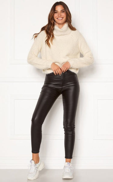 The Ariana Polo Neck Jumper is everything you need for Warm, Cosy Winter months.  It has Long Sleeves and a folded Polo Neckline. It is a cropped length and ideal for wearing with high waist Bottoms. It has a Soft, Fluffy feel adding luxury and comfort. Styling tip; Tuck it into our Brand New  Bianca Coated Jeans and style with Boots or Runners for a Daywear Look. This Jumper is composed mainly of Polyamide which is a durable synthetic fabric that washes and wears well, so expect to have this piece for many Winters to come.
