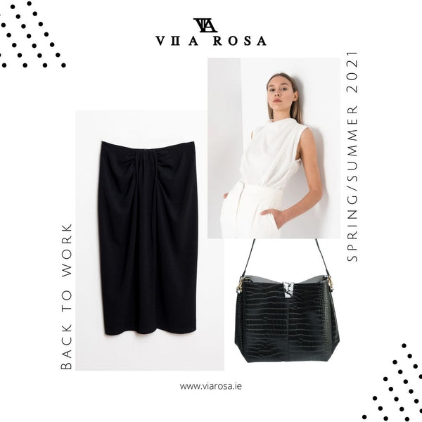 This is an image of our Camila Knotted Black midi skirt styled with our Danielle draped sleeveless blouse in White and our day to night Croc Bag