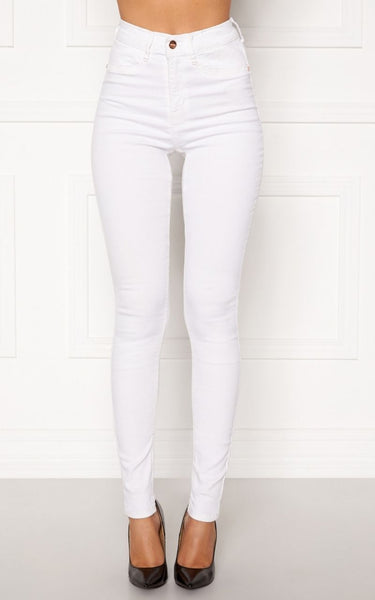 This is an Image of the Beverly White Jeans. White Jeans are a Must Have for your everyday Spring/Summer Wardrobe.  These Jeans are High Waisted with a Skinny Fit, They are Super Stretchy quality making them Comfortable at the same time.  They have Faux Front Pockets, Regular Back Pockets and functional Belt loops.