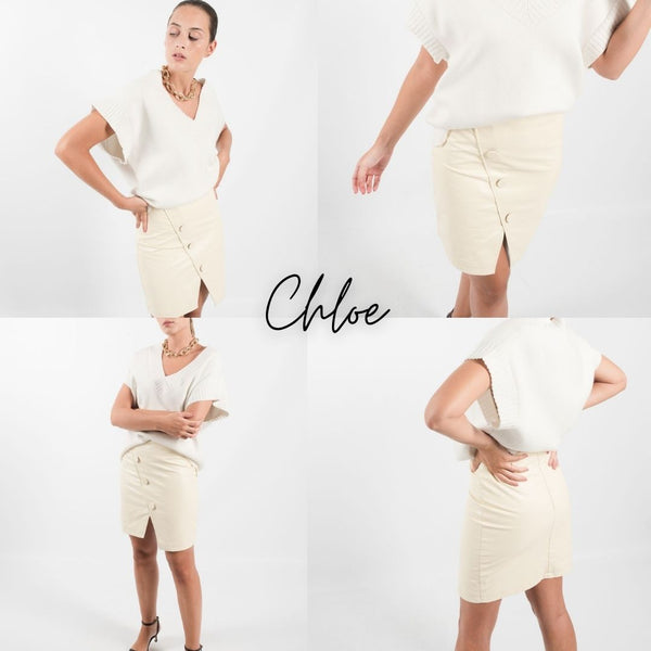 This is an image of the Chloe faux leather Mini Skirt which has round button details on the front.