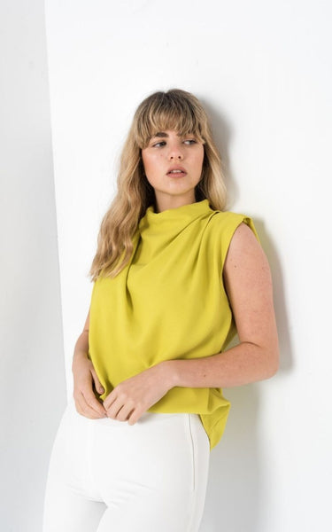This is an image of the Danielle Lime Blouse. Add a touch of Elegance with our Danielle Pleated Sleeveless Blouse  With a gather detail on the neck and a slight capped sleeve.   This Blouse has an invisible Zip closure down the back of the neckline.  Ideal for tucking into Jeans, Suit Pants or Skirts.  Available in Lime & White