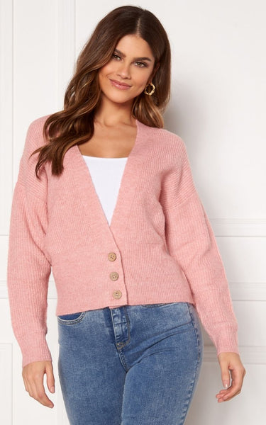 The Louisa is a Rib-Knit Cardigan with a V Neckline and Buttons at the front.  It is a Short Length Cardigan with Wide Sleeves and Ribbed Cuffs.  It has a Soft, Knit Quality and is Pink in colour with a Melange effect.  The Perfect way to add a Pop of Pink to your Spring/Summer Wardrobe.