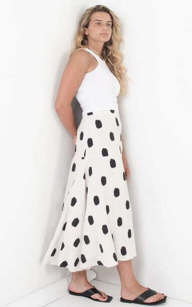 this is an image of a model wearing our Melanie Spotted Midi Skirt in Cream.