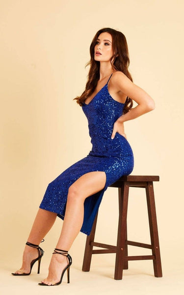This is an image of The Milan Sequin Bodycon Midi Dress with Slit in Electric Blue