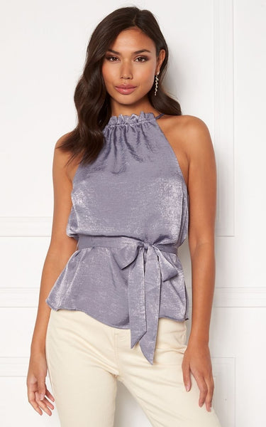 The Perfect Dressy Top for Styling with White Jeans or Trousers this Summer.   This Top has a High Neckline that ties at the back with a Keyhole Detail.    It has a Belt that can be Draped or tied into a Bow or Knot.